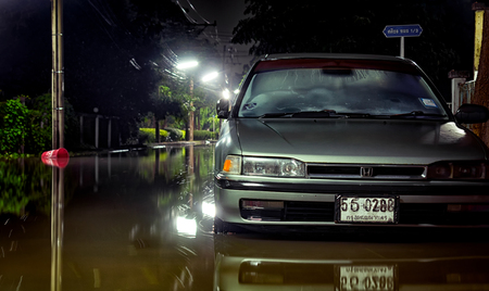BANGKOK, THAILAND - OCTOBER 15: Flood water level rises as the canal overflows in the middle of the night in Sasitorn Village in Bangkok on October 15, 2017. Editorial