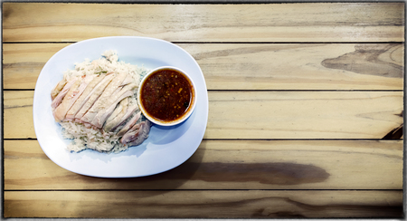 Chinese Hainan Styled Chicken Over Rice on a Wooden Background