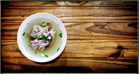 Traditional Chinese Style Chicken Bone Soup on a Wooden Background