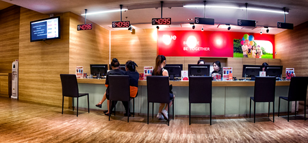 BANGKOK, THAILAND - OCTOBER 29 - TRUE shop service counter provides services to customers in The Mall Bangkhae in Bangkok on October 29, 2017. TRUE is a communication conglomerate in Thailand.
