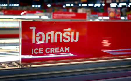 Sign in Thai that Reads Ice Cream in the Frozen Food Section Editorial