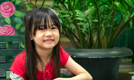 Portrait of a Bright and Healthy Young Asian Girl Outdoor Banco de Imagens