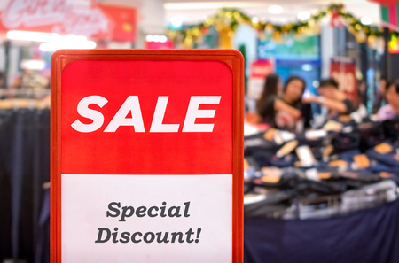 Red Special Discount Sale Sign in the Shopping Mall during the Holidays