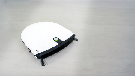 Modern Autonomous Robotic Vacuum Cleaner on White Marble Floor