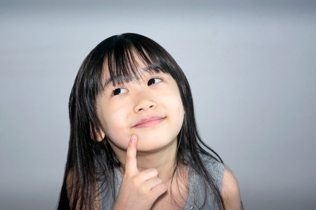Asian Little Girl  Actively Brainstorming New Ideas
