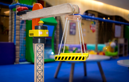 Wooden Toy Crane in a Indoor Playground Banco de Imagens