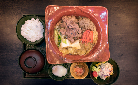 Japanese Sukiyaki Nabe Meal Set with various Side Dishes Banco de Imagens