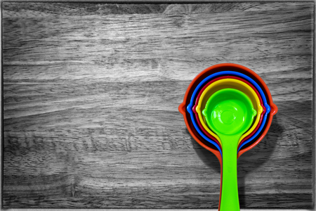 Set of Colorful Measuring Spoon on a Wooden Background