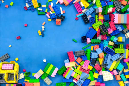 Colorful Childrens Plastic Building Bricks Scattered Around  Banco de Imagens