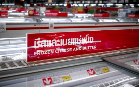 """Sign in Thai that Reads """"Frozen Cheese and Butter"""" in the Frozen Food Section"""