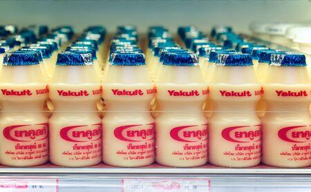 BANGKOK, THAILAND - NOVEMBER 28: Foodland supermarket fully stocks Yakult yogurt drinks in the refrigerated section in Bangkok on November 26, 2017.  Yakult is a probiotic dairy beverage from Japan.