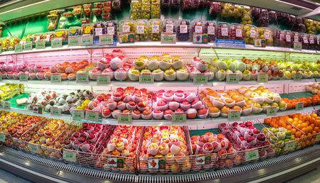 BANGKOK, THAILAND - FEBRUARY 10:Foodland supermarket displays various species of refrigerated apples and other fruits for sale in Bangkok and February 10, 2019.