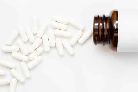 psychotropic medication: Pills spilling out of pill bottle