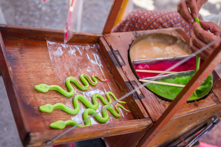 Ancient Thai style colorful candy sugar in vintage simmer pan 写真素材