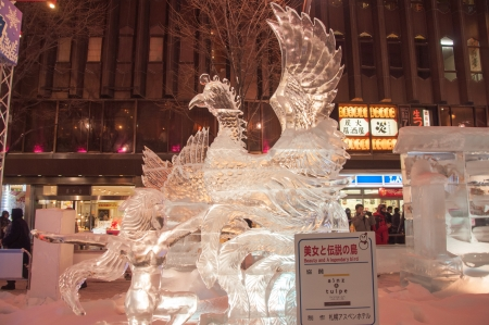 legendary: Sapporo, Japan - February 8, 2013  The 33rd Susukino Ice Festival  Photo showing a heroine and a legendary bird with the ice sculpture theme  Beauty and a legendary bird