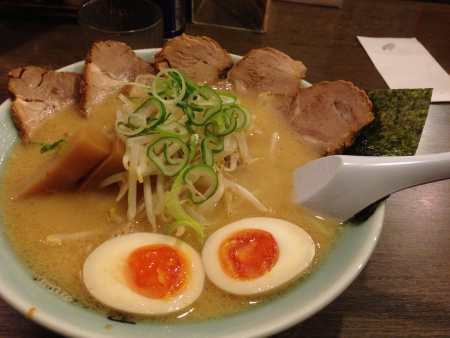 gist: A very famous ramen shop in Hokkaido that served ramen more than 100years and have branches all over Japan. The speciality of this delicacy lies in the soup where kilos of pig born was broiled for hours to extract the gist from the bones and produced a ri