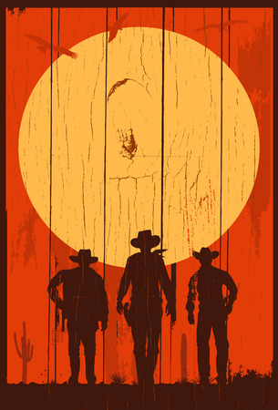 Silhouette of three cowboys walking forward on a wooden board