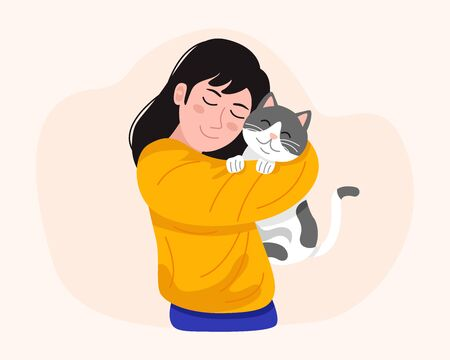 Young woman holding cute cat.
