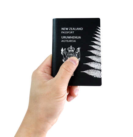 Man's hand holding New Zealand passport on white background 免版税图像 - 157248112