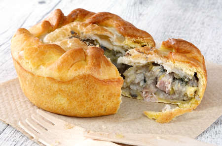 Close up of chicken and mushroom pie on a wooden table 免版税图像