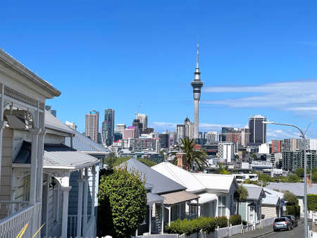 AUCKLAND, NEW ZEALAND - January 4, 2021: Residential houses in Ponsonby with Sky tower in the background