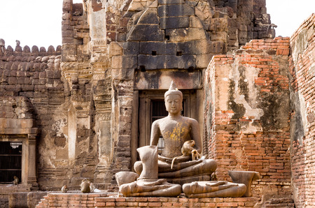 lop: Buddha statues with monkeys at Phra Prang Sam Yot in Lopburi, Thailand