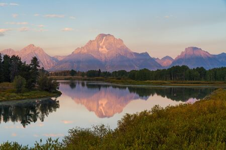 oxbow bend: Reflection of Grand Teton range at the waters at Oxbow bend during sunrise at Grand Teton National Park