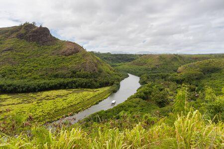 Wailua river with a boat in Kauai, Hawaii