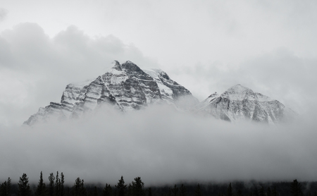 mountains and sky: Canadian Rocky Mountains Rising Above the Clouds Stock Photo