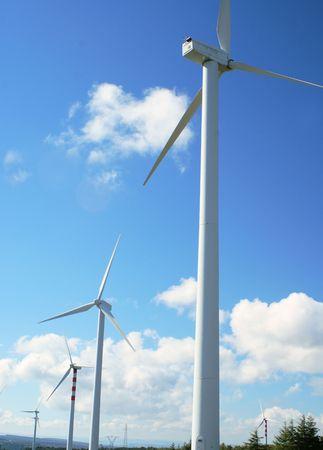generates: Wind power generators. Beautiful sky blue.