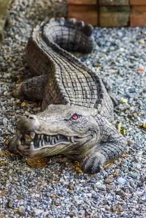 opening rock crocodile statue photo
