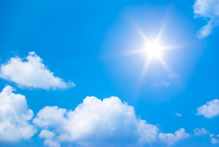 The sun shines bright in the daytime in summer. Blue sky and clouds. photo