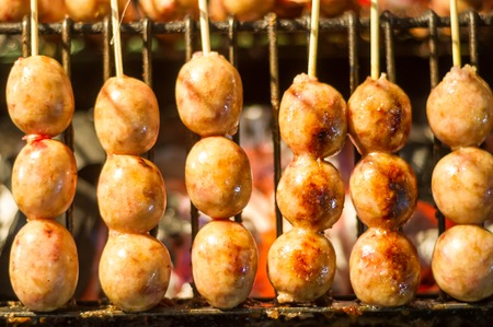 Thai Grilled Sausage on Street Market in Thailand photo