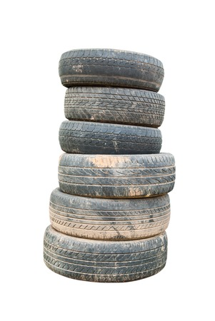 Old car tires on white background