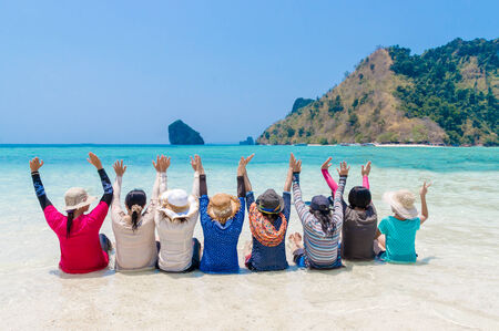Women show hands at Beach in Krabi Thailand photo