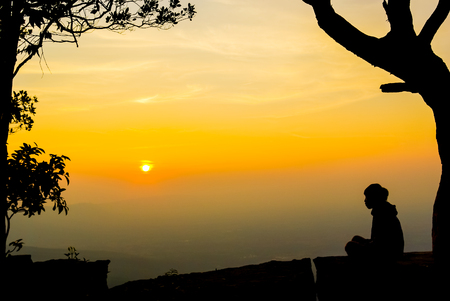 Woman meditation at sunrise on mountain. photo
