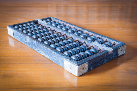 Old abacus on wooden table. photo