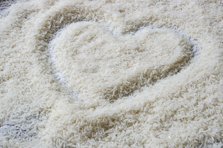 Uncooked jasmine rice heart sign photo