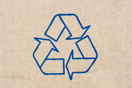 Recycle sign on paper texture. photo