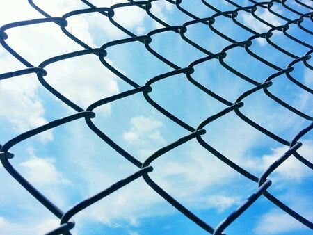 metal: Metal net and blue sky with cloud  Stock Photo