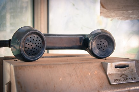 Old public coin-operated telephone,vintage. photo