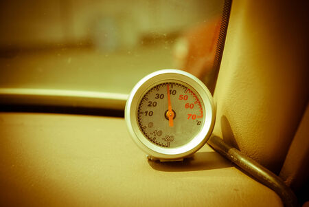 hotter: thermometer in the car. The heat Stock Photo