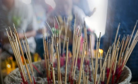Joss sticks is burning. photo