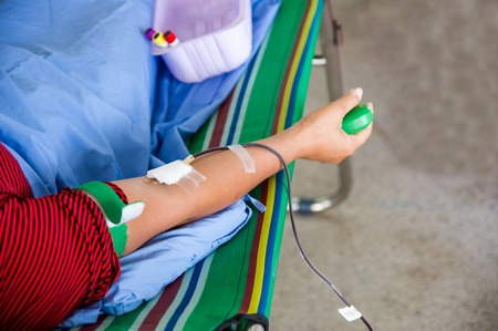 transfused: Closeup of blood donor at donation. Stock Photo