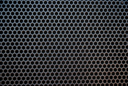Black speaker grid texture. Industrial background. photo