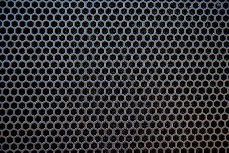Black speaker grid texture. Industrial background.