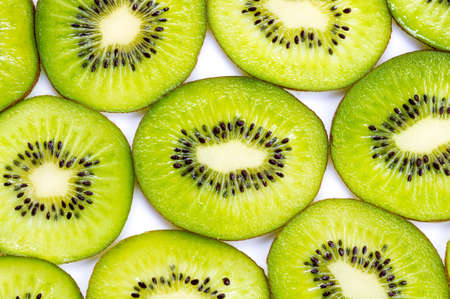 freshest: Many slices of kiwi fruit on white background.