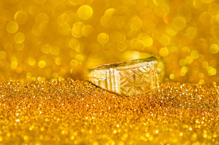 golden ring: Golden Ring on bokeh gold color abstract background.