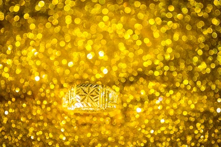 golden ring: Golden Ring on bokeh gold colour abstract background. Stock Photo
