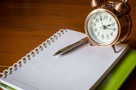 retro alarrm clock and notebook.